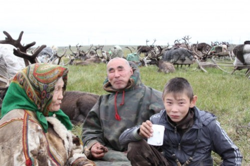 The blind elder Piotr Khudi with his family just before crossing Bovanenkovo gas deposit, Yamal Peninsula